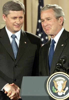Stephen Harper checks George Bush's shirt for lipgloss stains.