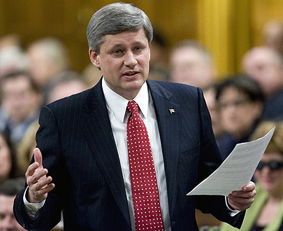 Stephen Harper trying out Roger Ebert's hair piece in public for the first time
