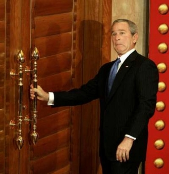 Bush confounded by complex physics of locked door.