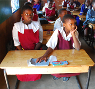 Provide desks to students in Malawi