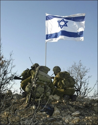 Israeli soldiers raising their flag in triumph on Lebanon